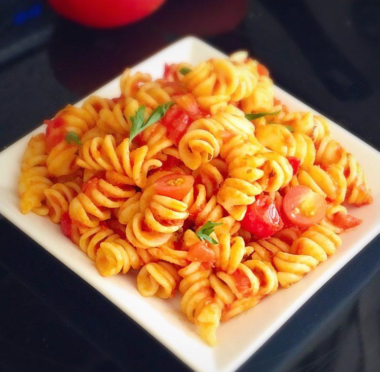 pasta,tomato pasta,creamy tomato pasta,how to make tomato pasta,italian food,italian,cream,tomato,tangy tomato pasta,rotini pasta,cherry tomato,tomato sauce,tomato pasta,rotini tomato pasta